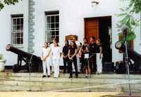 Local and visiting Bahá'ís performing on the Courthouse steps in Jamestown (1997)