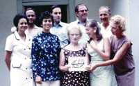 Members of the first Local Spiritual Assembly of St Helena, formed in April 1973. Left-to-right, Back row: Basil George, Cliff Huxtable, Richard Tranter, Eldon Dennis; Front Row: Jenny Corker, Delia Huxtable, Eunice Honey, Barbara George, Vivien Combe